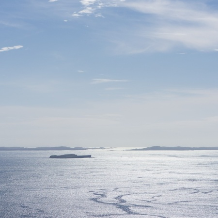 mull-cottages-treshnish-view-of-staffa-iona-shimmering-sea